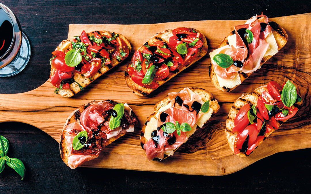 Bruschettas with tomato, avocado and balsamic cream